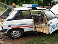 /df755e0c9e-police-car-transformed-into-a-chicken-coop